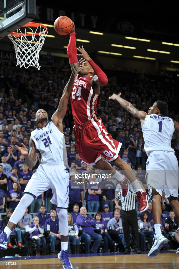 Forward Romero Osby #24 of the Oklahoma Sooners drives in for a dunk between defenders Jordan Henriquez #21 and Shane Southwell #1 of the Kansas State Wildcats during the first half on January 19, 2013 at Bramlage Coliseum in Manhattan, Kansas.