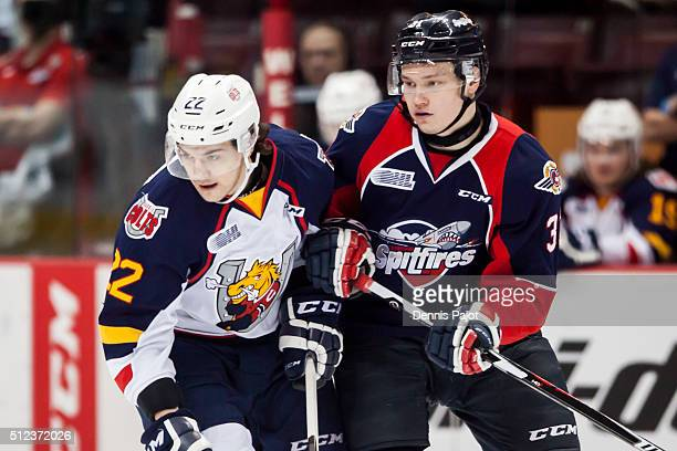 Forward Roy Radke of the Barrie Colts skates against defenceman Mikhail Sergachev of the Windsor Spitfires on February 25 2016 at the WFCU Centre in...