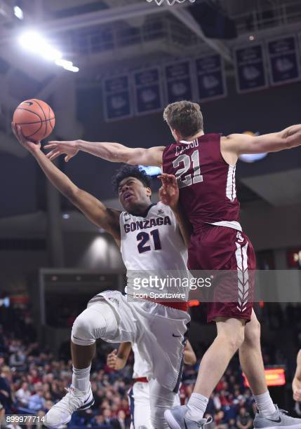 GU forward Rui Hachimura goes around the defense of Santa Clara forward Henry Caruso to score during the game between the Santa Clara Broncos and the...