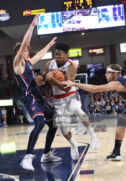 GU forward Rui Hachimura protects the ball from the reach of St Mary's forward Calvin Hermanson as St Mary's guard Tanner Krebs defends during the...
