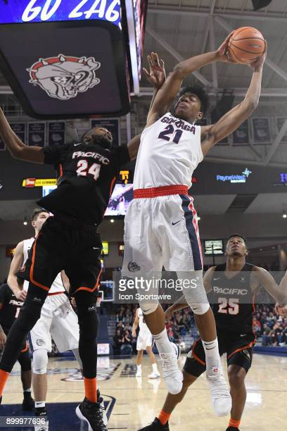 GU forward Rui Hachimura pulls in a rebound as Pacific center Namdi Okonkwo contests the play during the game between the Pacific Tigers and the...