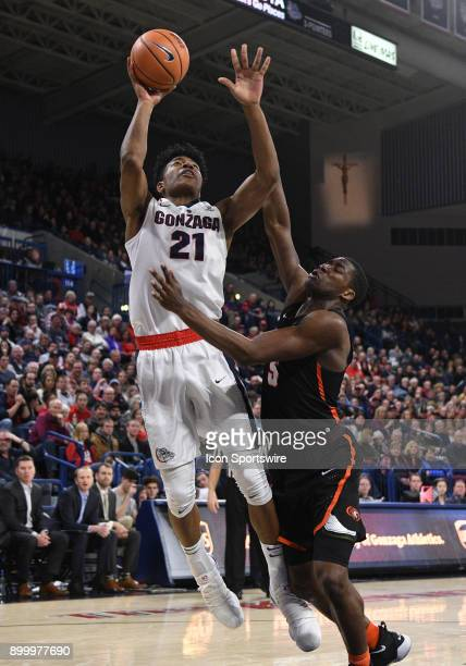 GU forward Rui Hachimura scores against the defense of Pacific forward Anthony Townes during the game between the Pacific Tigers and the Gonzaga...