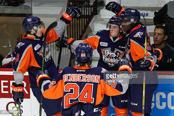 Forward Ryan Moore of the Flint Firebirds celebrates his goal against the Windsor Spitfires on October 13 2016 at the WFCU Centre in Windsor Ontario...