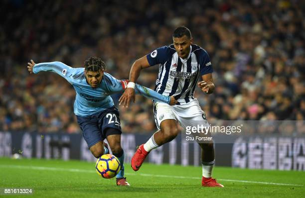 WBA forward Salomon Rondon challenges DeAndre Yedlin of Newcastle during the Premier League match between West Bromwich Albion and Newcastle United...