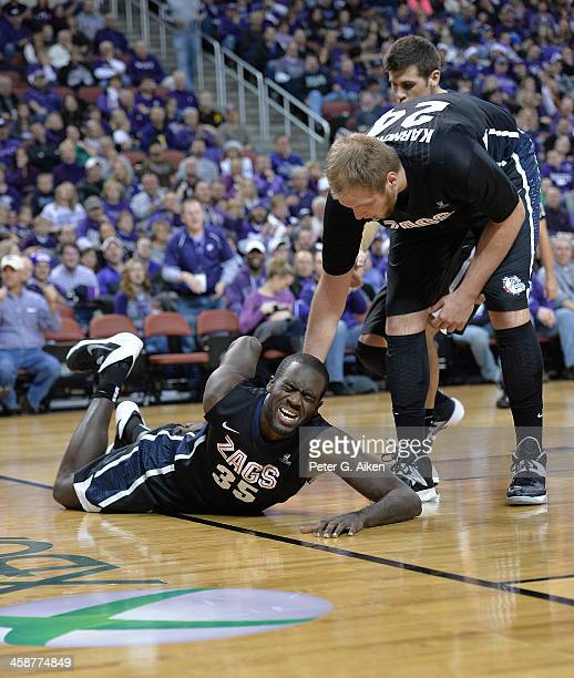 Forward Sam Dower Jr #35 of the Gonzaga Bulldogs reacts after hurting his back against the Kansas State Wildcats during the first half on December 21...