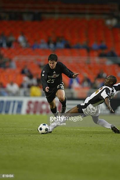 Forward Santino Quaranta of DC United dribbles past defender Joe Addo of the New York/New Jersey MetroStars during the MLS match at the RFK Memorial...