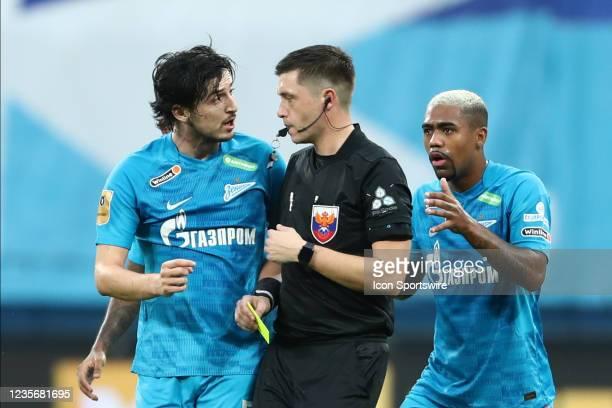 Forward Sardar Azmoun of FC Zenit and forward Malcom of FC Zenit telks to the referee Pavel Shadyhanov during Russian Premier League match FC Sochi v...