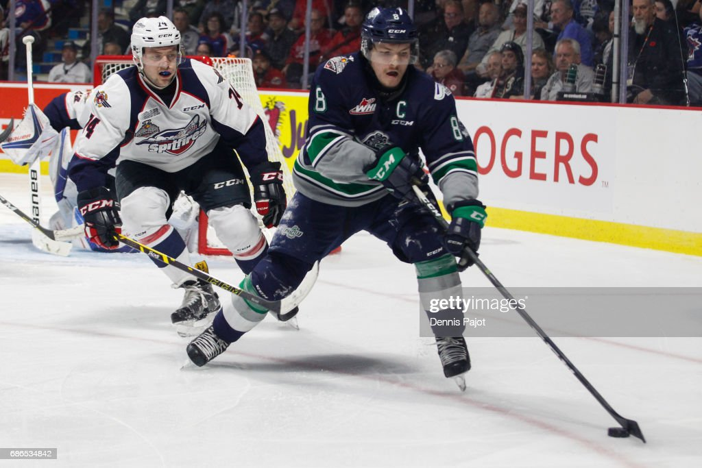 Forward Scott Eansor #8 of the Seattle Thunderbirds moves the puck against defenceman Sean Day of the Windsor Spitfires on May 21, 2017 during Game 3 of the Mastercard Memorial Cup at the WFCU Centre in Windsor, Ontario, Canada.