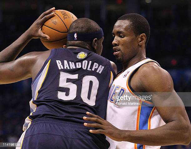 Forward Serge Ibaka of the Oklahoma City Thunder guards against Zach Randolph of the Memphis Grizzlies in Game Seven of the Western Conference...