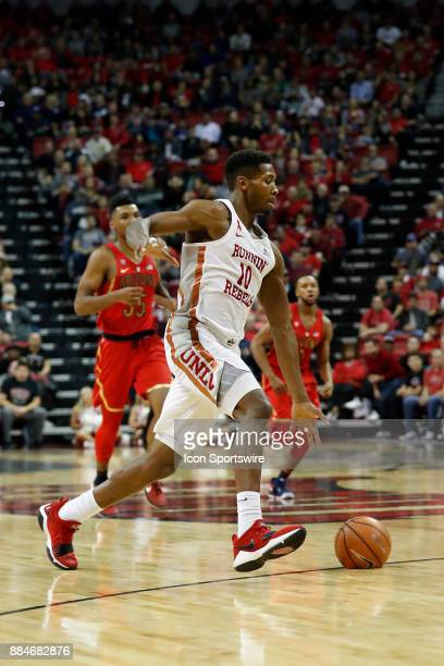 UNLV forward Shakur Juiston dribbles the ball up the court during the game between the Arizona Wildcats and the University of Nevada Las Vegas Rebels...