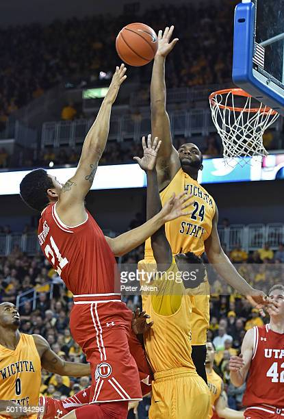 Forward Shaquille Morris of the Wichita State Shockers blocks the shot of forward Jordan Loveridge of the Utah Utes during the second half on...