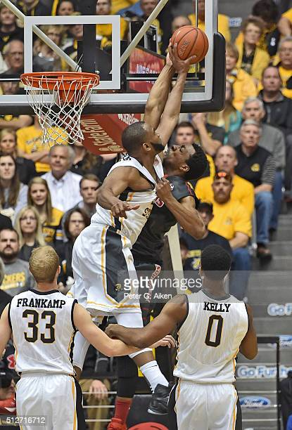 Forward Shaquille Morris of the Wichita State Shockers blocks the dunk attempt of forward Mikyle McIntosh of the Illinois State Redbirds during the...