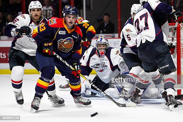 Forward Shaun Bily of the Erie Otters watches as a rebound bounces away from the net against goaltender Michael DiPietro of the Windsor Spitfires on...