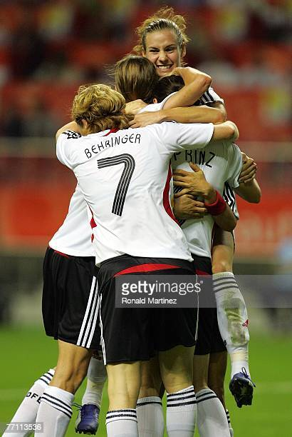 Forward Simone Laudehr of Germany celebrates a goal by Birgit Prinz against Brazil during the FIFA Women's World Cup 2007 final match at Shanghai...
