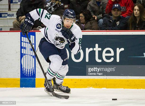 Forward Sonny Milano of the Plymouth Whalers moves the puck against the Windsor Spitfires on February 18 2015 at the WFCU Centre in Windsor Ontario...