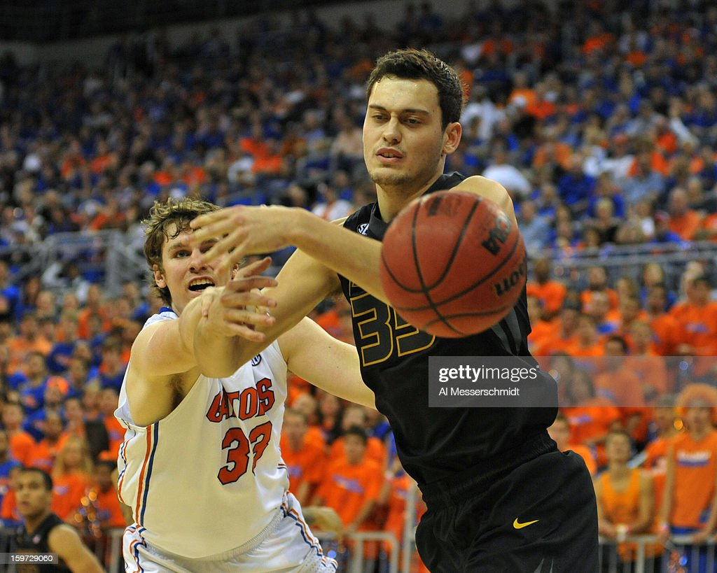 Forward Stefan Jankovic #35 of the Missouri Tigers looks for a rebound in front of forward Erik Murphy #35 of the Florida Gators January 19, 2013 at Stephen C. O'Connell Center in Gainesville, Florida. The Gators won 83 - 52.