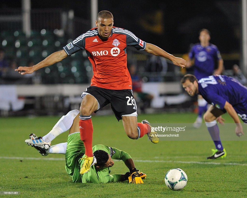 Forward Taylor Morgan #28 of Toronto FC jumps over goalie Miguel Gallardo #1 of Orlando City February 13, 2013 and scores a second period goal in the second round of the Disney Pro Soccer Classic in Orlando, Florida. Morgan scored a goal in the second period.