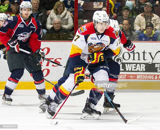 Forward Taylor Raddysh of the Erie Otters moves the puck against the Windsor Spitfires on March 19 2015 at the WFCU Centre in Windsor Ontario Canada