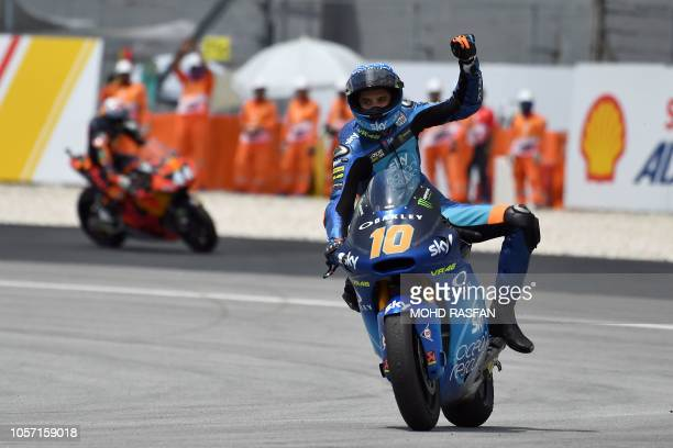 Forward Team's Italian rider Luca Marini celebrates after winning the Moto2 race of the Malaysia MotoGP at the Sepang International Circuit in Sepang...