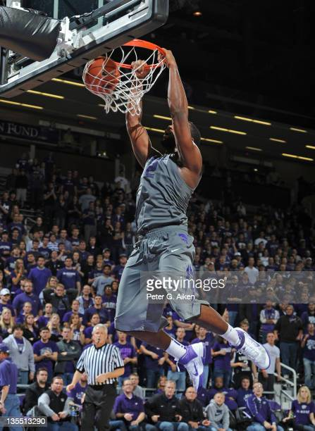 Forward Thomas Gibson of the Kansas State Wildcats dunks the ball against the North Florida Ospreys during the second half on December 11 2011 at...