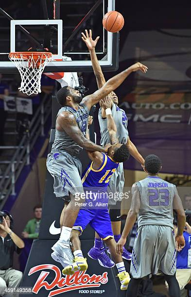 Forward Thomas Gipson of the Kansas State Wildcats fouls guard Martez Harrison of the UMKC Roos during the second half on November 17 2014 at...