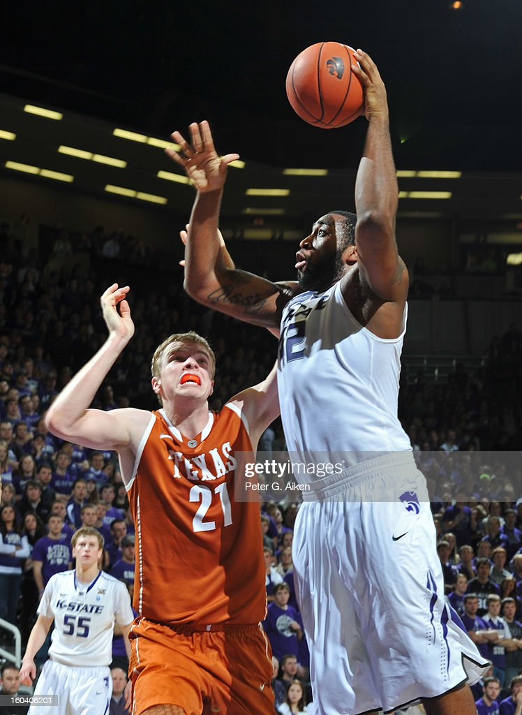 Forward Thomas Gipson #42 of the Kansas State Wildcats scores against forward Connor Lammert #21 of the Texas Longhorns during the second half on January 30, 2013 at Bramlage Coliseum in Manhattan, Kansas. Kansas State defeated Texas 83-57.