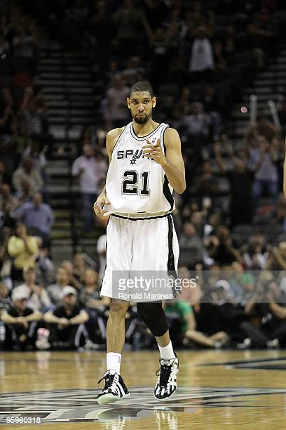 Forward Tim Duncan of the San Antonio Spurs reacts after making his 20000 career point against the Houston Rockets at ATT Center on January 22 2010...