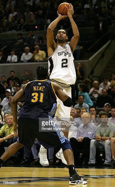 Forward Tim Duncan of the San Antonio Spurs takes a shot against Nene of the Denver Nuggets in Game One of the Western Conference Quarterfinals...