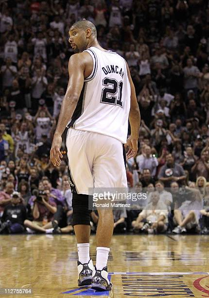 Forward Tim Duncan of the San Antonio Spurs walks off the court after fouling out against the Memphis Grizzlies in Game Two of the Western Conference...