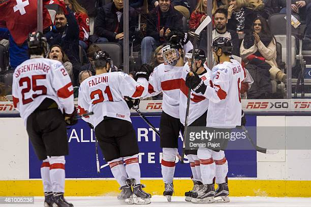 Forward Timo Meier of Switzerland celebrates a goal against Germany during the 2015 IIHF World Junior Championship on January 03 2015 at the Air...