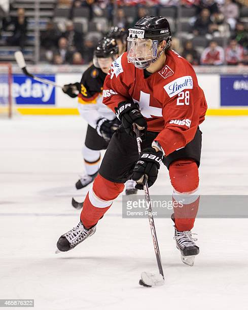 Forward Timo Meier of Switzerland moves the puck against Germany during the 2015 IIHF World Junior Championship on January 02 2015 at the Air Canada...