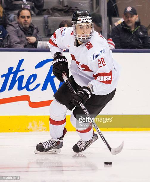 Forward Timo Meier of Switzerland moves the puck against Germany during the 2015 IIHF World Junior Championship on January 03 2015 at the Air Canada...