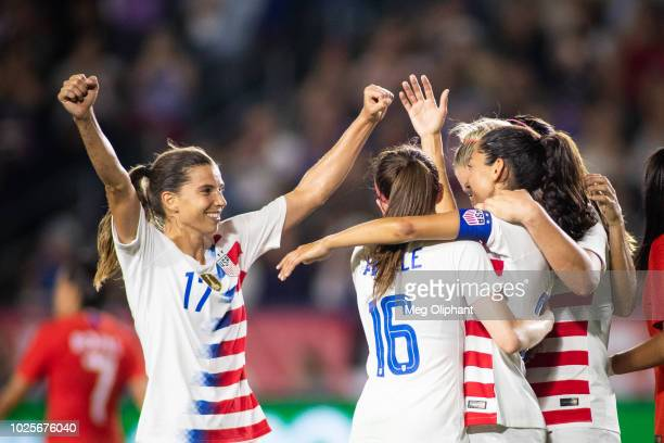 Forward Tobin Heath of the U.S. Women's National team joins Rose Lavelle and Christen Press in celebration during the friendly match against Chile at...