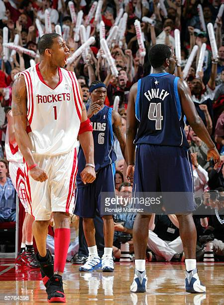 Forward Tracy McGrady of the Houston Rockets reacts after hitting a shot and drawing the foul against the Dallas Mavericks in Game six of the Western...