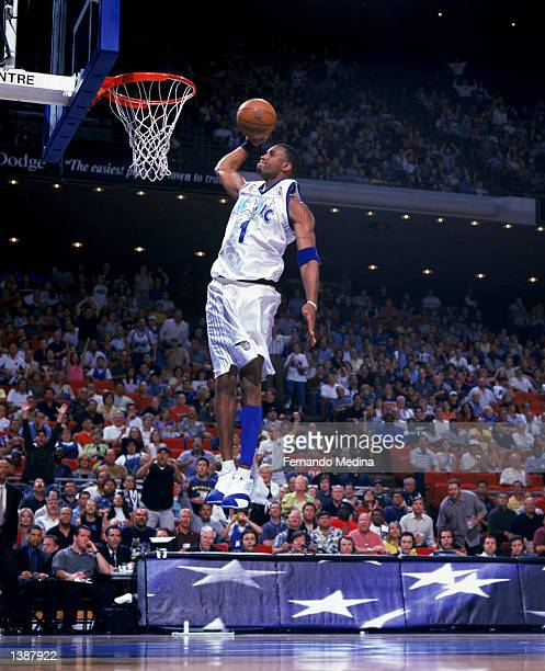 Forward Tracy McGrady of the Orlando Magic dunks the ball during the NBA game on April 11 2002 against the New Jersey Nets at the TD Waterhouse in...