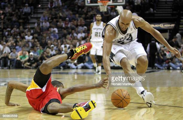 Forward Trevor Ariza of the Houston Rockets falls while reaching for the ball against Richard Jefferson of the San Antonio Spurs at ATT Center on...