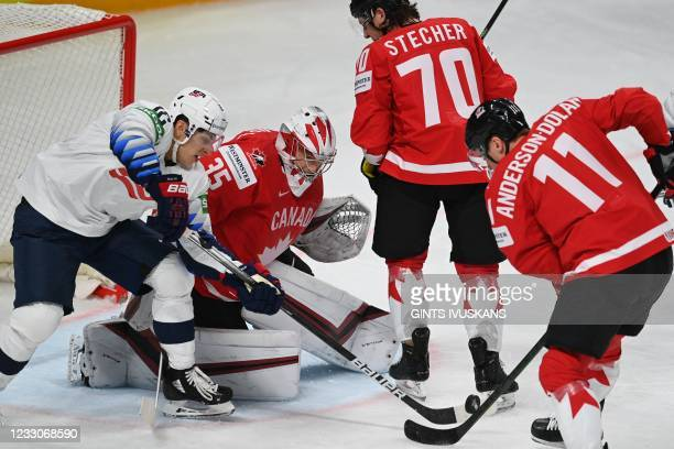Forward Trevor Moore vies for the puck with Canada's goalkeeper Darcy Kuemper, Canada's defender Troy Stecher and Canada's forward Jaret...