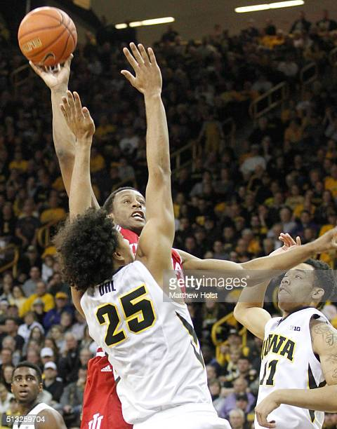 Forward Troy Williams of the Indiana Hoosiers goes to the basket between forward Dom Uhl and guard Christian Williams of the Iowa Hawkeye in the...
