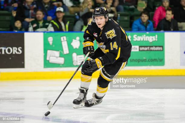 Forward Ty Lewis of the Brandon Wheat Kings brings the puck into the neutral zone during the third period in a game between the Everett Silvertips...