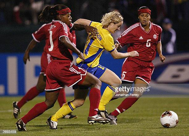 Forward Victoria Svensson of Sweden dribbles past forward Charmaine Hooper of Canada during the semifinals of the 2003 FIFA Women's World Cup match...