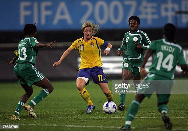 Forward Victoria Svensson of Sweden moves the ball against Christie George of Nigeria during the FIFA Women's World Cup 2007 Group B match at the...