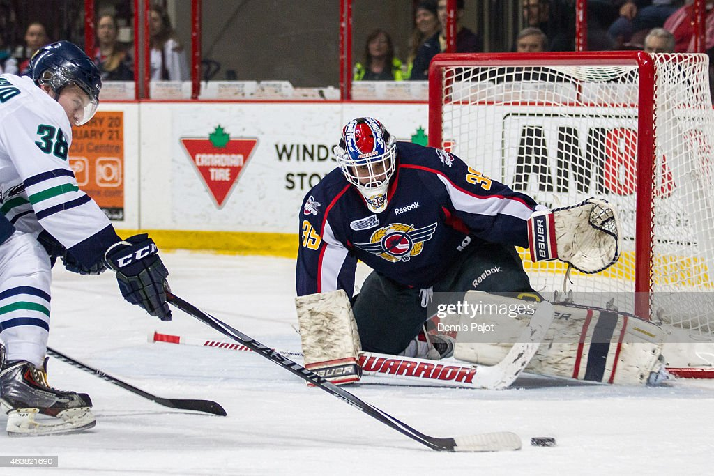 Forward Vincent Scognamiglio #38 of the Plymouth Whalers drives the net against goaltender Alex Fotinos #39 of the Windsor Spitfires on February 18, 2015 at the WFCU Centre in Windsor, Ontario, Canada.