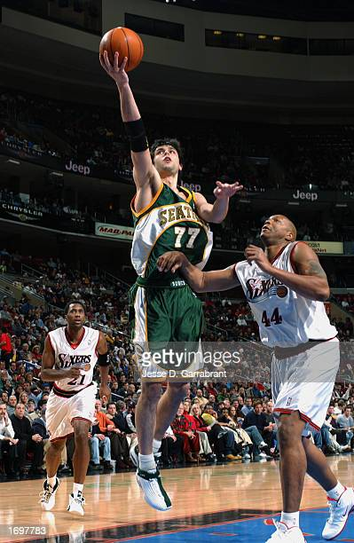 Forward Vladimir Radmanovic of the Seattle Sonics shoots a layup against forward Derrick Coleman of the Philadelphia 76ers during the NBA game at...