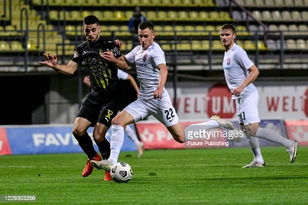 Forward Vladyslav Kabaiev of FC Zorya Luhansk and defender Milos Stamenkovic of FC Rukh Lviv are seen in action during the Ukrainian Premier League...