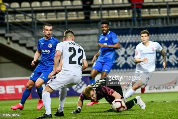 ZAPORIZHZHIA UKRAINE Forward Vladyslav Kabaiev of FC Zorya Luhansk competes for the ball with goalkeeper Bohdan Sarnavskyi of PFC Lviv during the...