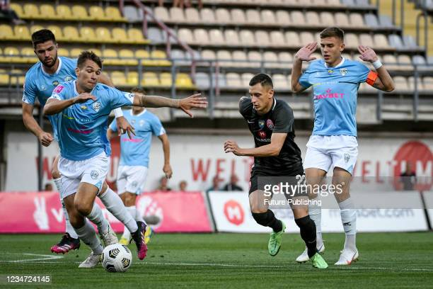 Forward Vladyslav Kabaiev of FC Zorya Luhansk is seen in action with players of FC Minaj during the 2021/2022 Ukrainian Premier League Matchday 4...