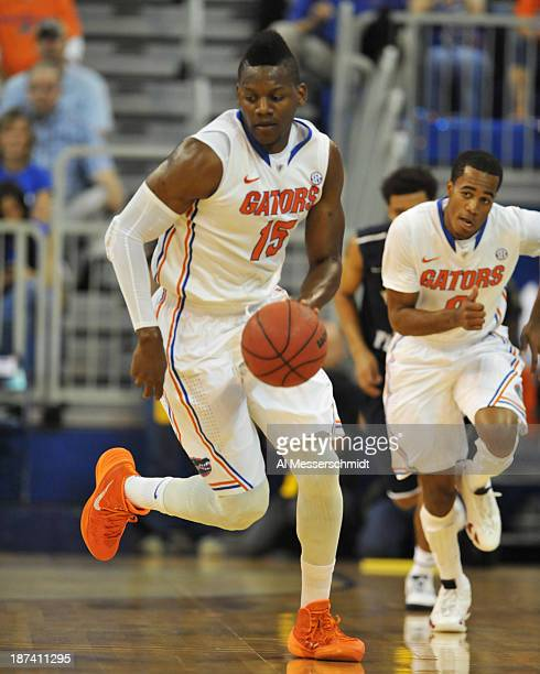 Forward Will Yeguete of the Florida Gators runs up court after a 1st half steal against the North Florida Ospreys November 8 2013 at the Stephen C...