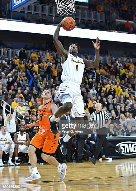 Forward Zach Brown of the Wichita State Shockers drives in for a basket past guard Phil Forte III of the Oklahoma State Cowboys during the second...