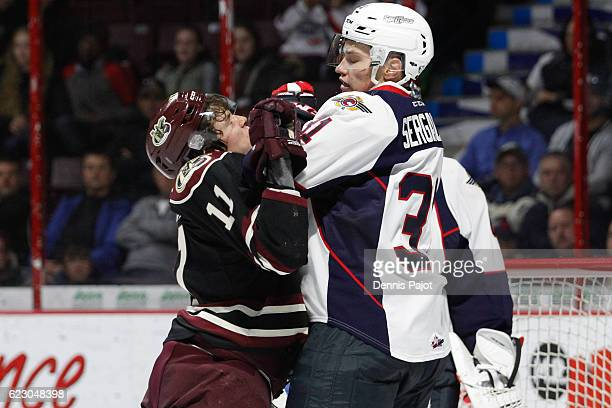 Forward Zach Gallant of the Peterborough Petes battles in front of the net against defenceman Mikhail Sergachev of the Windsor Spitfires on November...