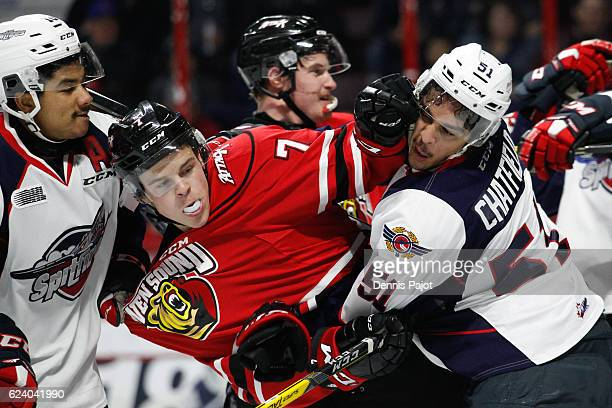 Forward Zachary Roberts of the Owen Sound Attack battles in front of the net against defenceman Jalen Chatfield of the Windsor Spitfires on November...